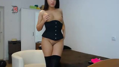 Youstinah in a black corset
