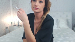 Beauty GlamorNikki smokes in front of webcam