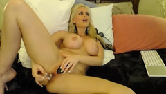 Azblonde fucks herself with glass dildo