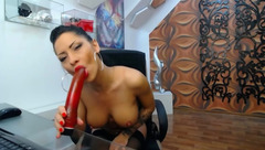 DivaClara sucks red dildo