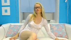 Bespectacled blonde Gwen Toffy fingering her ass