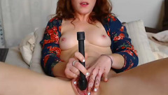 Redhead Gingerbreadnookie masturbating with black vibrator