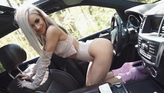 EvelynDiamond with a car in the woods