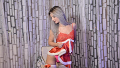 Lustful blonde FelinaSweet in hot peignoir and white nylon stockings is posing in front of the webcam