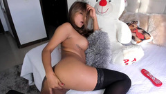 Impressive hot brown haired Camilagomezz in black stockings is hotly masturbating with vibrator