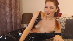 Redhead milf is taking off black latex dress and showing small tits