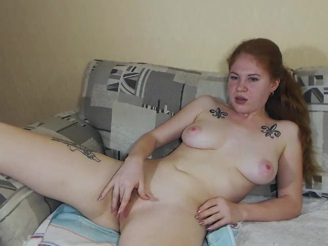 Horny amateur Emma Reds is wide spreading legs and hotly fingering her shaved pussy