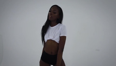 Stunning sexy black girl SandyLing is showing off her body wearing white shirt and green knee socks