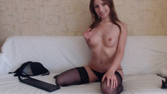 Sexy shaped young brunette B Alice in nylon stockings is undressing in front of the webcam