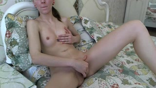 Adorable young Alanna Skye with sexy small boobies is enjoying stroking shaved pussy
