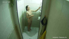 Exciting charming young brunette girl Rose is undressing and getting in shower