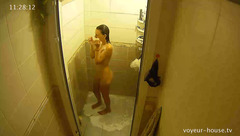 Slender girl Rose is getting in shower and stroking boobies
