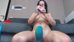 Cam model Naughtyelle shows her new sex toy