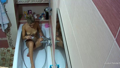 Brunette with sexy cute boobies is washing up and shaving young tight cunt
