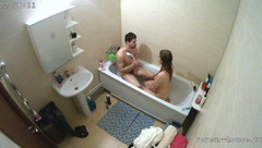 Sexy brunette is taking bath with boyfriend and shaving young pussy