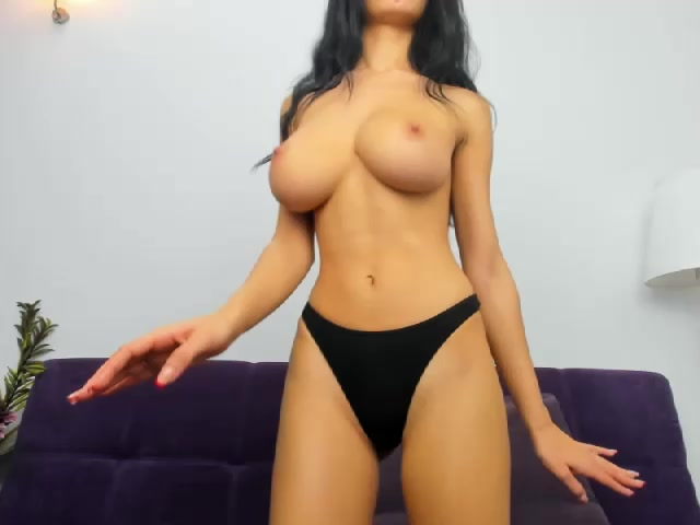 Stunning slender shaped young brunette AnyaFox is hotly posing in front of the webcam