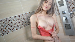 Scrawny EkaterinaWoods with hot round boobies is hotly posing to the webcam
