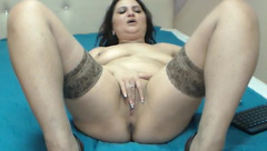 Fat mature brunette Whitney Lova is lying in front of the webcam and fingering her plump cunt