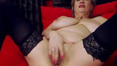 Fatty mature lady Lacy Cumming is black stockings is masturbating cunt and stuffing asshole with big dildo