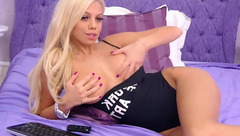 Slender hot luxurious blonde PrettyElly is showing off in black bodysuit
