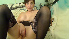 Gorgeous hot housewife Nora Angelika is posing to the webcam in black stockings