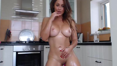 Redhead juicy chick Melissa_sucre is posing and oiling up her mouthwatering body in kitchen