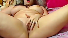 Burning hot girl is showing off juicy big breasts and stroking pussy