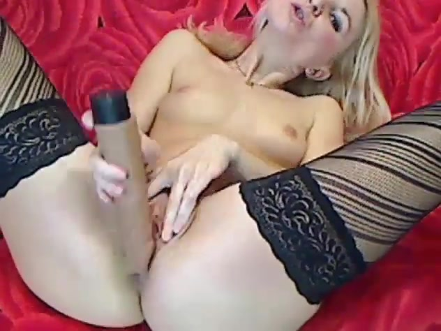 Sexy blonde girl in black lace stockings is sucking big dildo and masturbating her shaved cunt