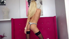 Awesome young blonde chick Iovana in hot black stockings is excitingly posing to the webcam