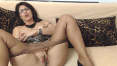 Naughty milf is pulling down pantyhose and drilling cunt with vibrator dildo