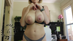 Big boobed blonde Auroraxoxo is stripping and stroking tits before sucking dildo dick