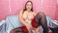 Redhead fatty slut Milly Turner is posing in black stockings before drilling cunt with dildo