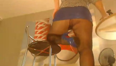 Brown haired buxom milf GoodWitch in black pantyhose is flashing her juicy butt underskirt