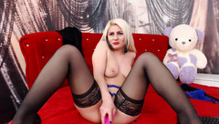 Passionate blonde Evelyn Diva in black stockings is hotly fucking her cunt with vibrator dildo