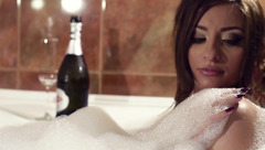 Luxurious hot brunette Natalielynn is taking bath and drinking champagne