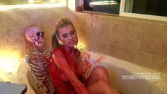 Big boobed blonde TheStellarGF is messing up in blood in the bath with skeleton