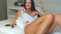 Sexy brunette nurse Vizaviii is hotly pulling off her sex uniform and showing boobs