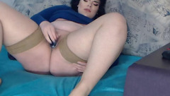 Fat brunette AbbyLee is enjoying fucking her shaved cunt with vibrator dick