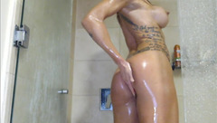 Burning hot milf JennyJinx is stroking ass and cunt in shower in front of the webcam