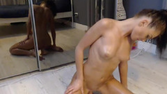 Skinny slender shaped Yveline is showing of her sexy small boobies and stroking shaved pussy