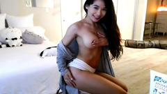 Alluring sexy young Asian camgirl Lemontea is hotly fondling her round boobs and posing to the webcam