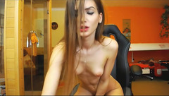 Skinny webcam chick BellaEla is showing off her tiny tits and stroking shaved cunt