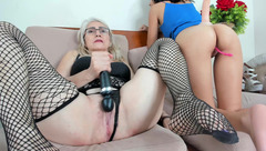Blonde granny KendallNcleo in black fishnet stockings is masturbating twat with vibrator
