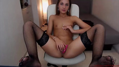 Delightful sexy MelissaCalypso is undressing and masturbating shaved pussy with dildo