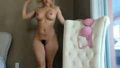 Appetizing tight blonde Surecakes is hotly posing to the webcam and showing hairy pussy