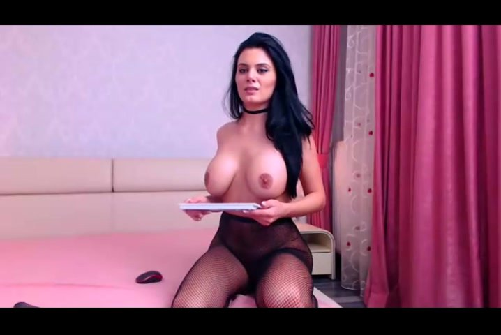 Brunette Karrin is excitingly posing to the webcam in black stockings