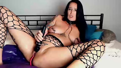 Steaming hot brunette SquirtingLinsey in black fishnet stockings is masturbating with sex toys