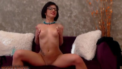 Exciting hot brunette Krina is undressing and hotly masturbating shaved cunt