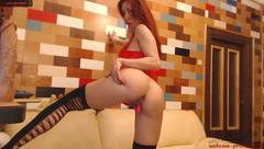 Skinny shaped ginger 3sexxx3 in black sexy stockings is hotly posing to the webcam and masturbating