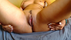 Buxom tight webcam milf Ffainna is posing nude to the webcam and fingering her shaved pussy